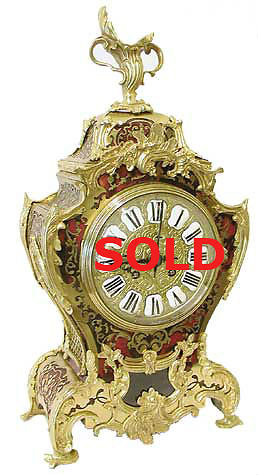 Mantel Clocks . Large red boulle sold